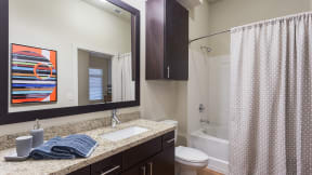 Framed mirrors are standard and add an upscale touch to your home. at Eleven by Windsor, Austin