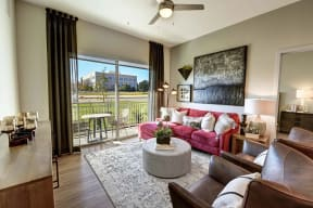 Decorated living room at Windsor Preston, 7950 Preston Road, Plano
