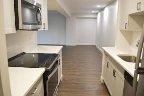 Enjoy gray vinyl plank flooring, new paint and new recessed lighting in all of our renovated homes at Windsor Village at Waltham, Massachusetts, 02452
