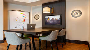 Conference table and TV at The Ridgewood by Windsor, Fairfax, Virginia
