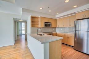 Modern kitchen with breakfast bar at Sea Castle, Santa Monica