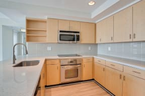 Modern kitchen with stainless steel appliances at Sea Castle, Santa Monica