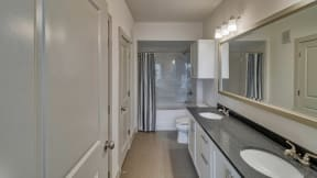 Dual Vanities with Contemporary Lighting at Windsor Oak Hill, 6701 Rialto Blvd, Austin
