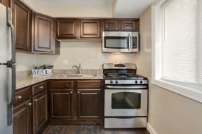Kitchen with stove, oven, sink and microwave