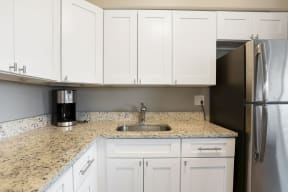 Kitchen with sink, coffee maker and cabinets