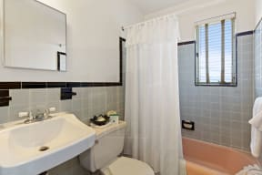 Bathroom with sink, toilet, shower