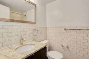 Bathroom with vanity, mirror, toilet