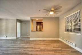 Apartments for Rent in Larkspur CA - Larkspur Courts Living Room with a Ceiling Fan, Wood Flooring, and More