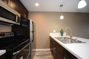 Chatsworth CA Apartments for Rent - Kitchen Complete with Convenient Amenities Like Fridge, Microwave, and Stove and Modern Cabinets