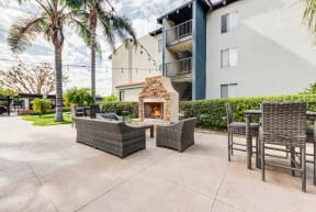 outdoor seating area with community fire pit