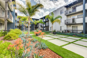 Apartments in Chatsworth CA - Exterior View of Waterstone Apartments Building During Daylight Featuring Beautiful Green Landscaping