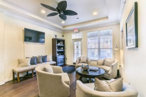 Cable Ready Living Room with Ceiling Fan at Aventura at Forest Park, St. Louis, MO