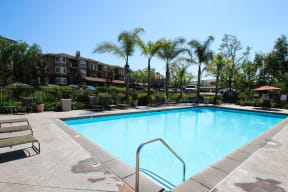 Pet-Friendly Apartments in Chino Hills CA-Missions at Chino Hills Sparkling Pool with Lounge Chairs, Spa, and Many More Amazing Community Amenities