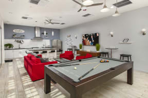 Clubroom kitchen and living area with TV and pool table