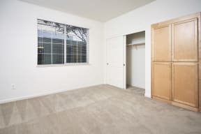 One Bedroom Apartments in San Jose, CA - Aviara Apartments Bedroom with Entrance to Patio and Spacious Layouts