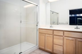 San Jose, CA Apartments for Rent - Aviara Apartments Bathroom with Wooden Cabinetry, Shower, and Bathtub