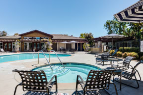 Outdoor pool and jacuzzi area with seating