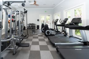 Apartments for Rent in Chino Hill CA - Spacious Fitness Center with Stylish Interior and Various Gym Equipment