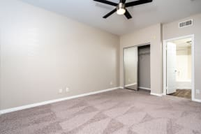 unfurnished bedroom with ceiling fan
