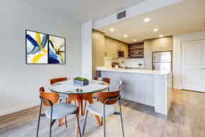 Dining area and kitchen with stainless steel appliances