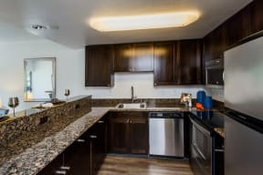 Palo Alto CA Apartments for Rent - Fully Equipped Kitchen with Stylish Interiors and Convenient Amenities such as Fridge, Stove, Microwave, and Dishwasher