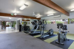 Apartments Palo Alto CA - Expansive Fitness Center Featuring Various Gym Equipment