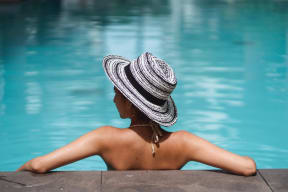 Woman Relaxing In A Pool at The Teale, Kissimmee