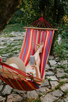 Woman Relaxing On Hammock at The Teale, Florida, 34746