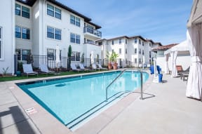 Pool with lounge chairs   Ageno Apartments in Livermore, CA