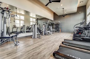 Gym with fitness equipment   Ageno Apartments in Livermore, CA