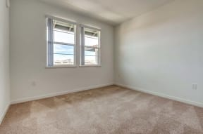 Bedroom with window   Ageno Apartments in Livermore, CA