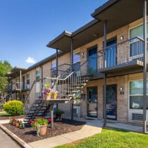 Condos at the Villager Apartment Building Exterior with Two-Levels and Landscaped Walkways