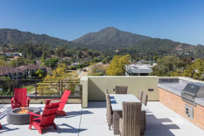 Rooftop seating area with firepit and grill