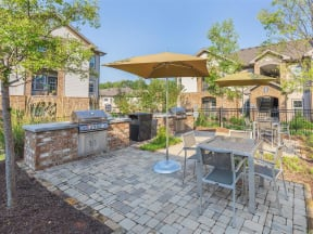 Outdoor Living Area Including Bbq'S And Fire Pits at One White Oak, Cumming, Georgia