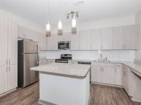 Gourmet Kitchen With Islands at One White Oak, Cumming, 30041