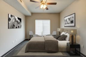 Bedroom with ceiling fan and queen sized bed