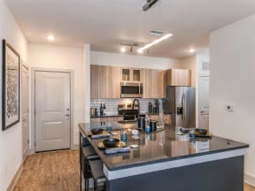 Gorgeous dining room space between kitchen and living room in Coda Orlando rentals in Orlando, FL