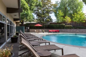 Outdoor pool area with lounge chairs