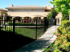 Sidewalk by fence l Vineyard Gate Apartments in Roseville CA