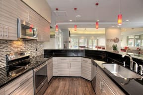 Large Kitchen in game area Apartments in Pittsburg, CA l Kirker Creek Apartments