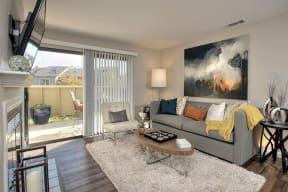 Living Room with patio Pet-Friendly Apartments in Pittsburg CA -Kirker Creek Living Room