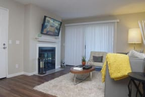 Living Room  with fireplace Apartments in Pittsburg, CA l Kirker Creek Apartments
