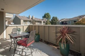Patio with table and chair Apartments in Pittsburg, CA l Kirker Creek Apartments