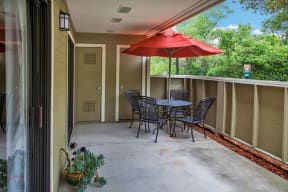 Patio with table and chairs Apts for rent in Pittsburg, CA 94565 l Kirker Creek Apartments