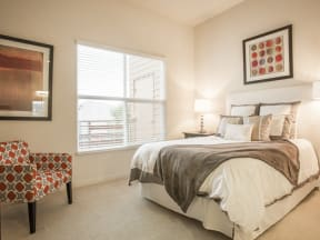 Furnished bedroom with window Apartments in San Mateo, CA - Mode Apartments Bedroom