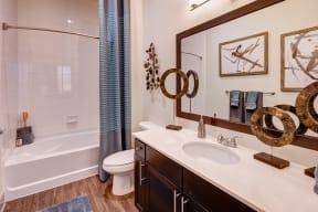Large mirror in bathroom at Windsor at Pinehurst, Lakewood, CO