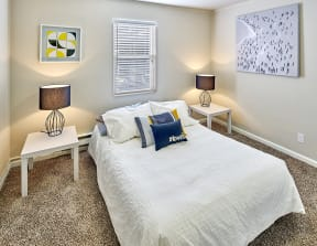 Carpeted bedroom to fit a queen sized bed and two side tables. One window over the bed.