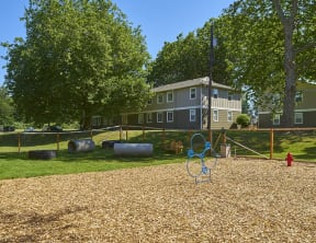 Pet park with wood chips outside of the community.