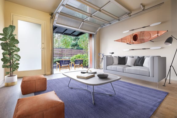 Staged Living room with open garage door