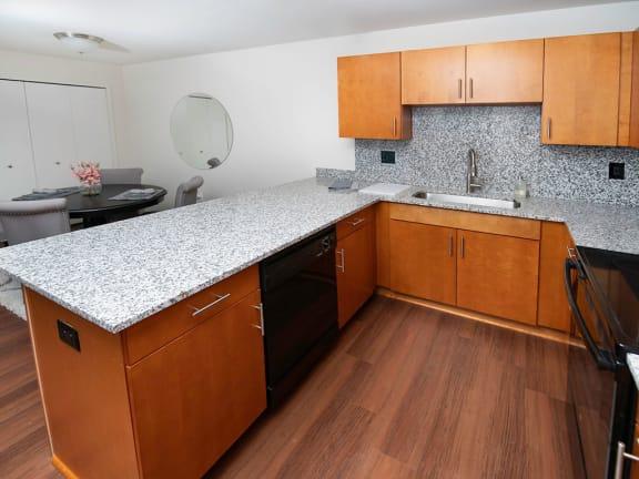 Kitchen with Tile Backsplash at Gray Estates Apartments, MRD Conventional, St Clair MI 48079